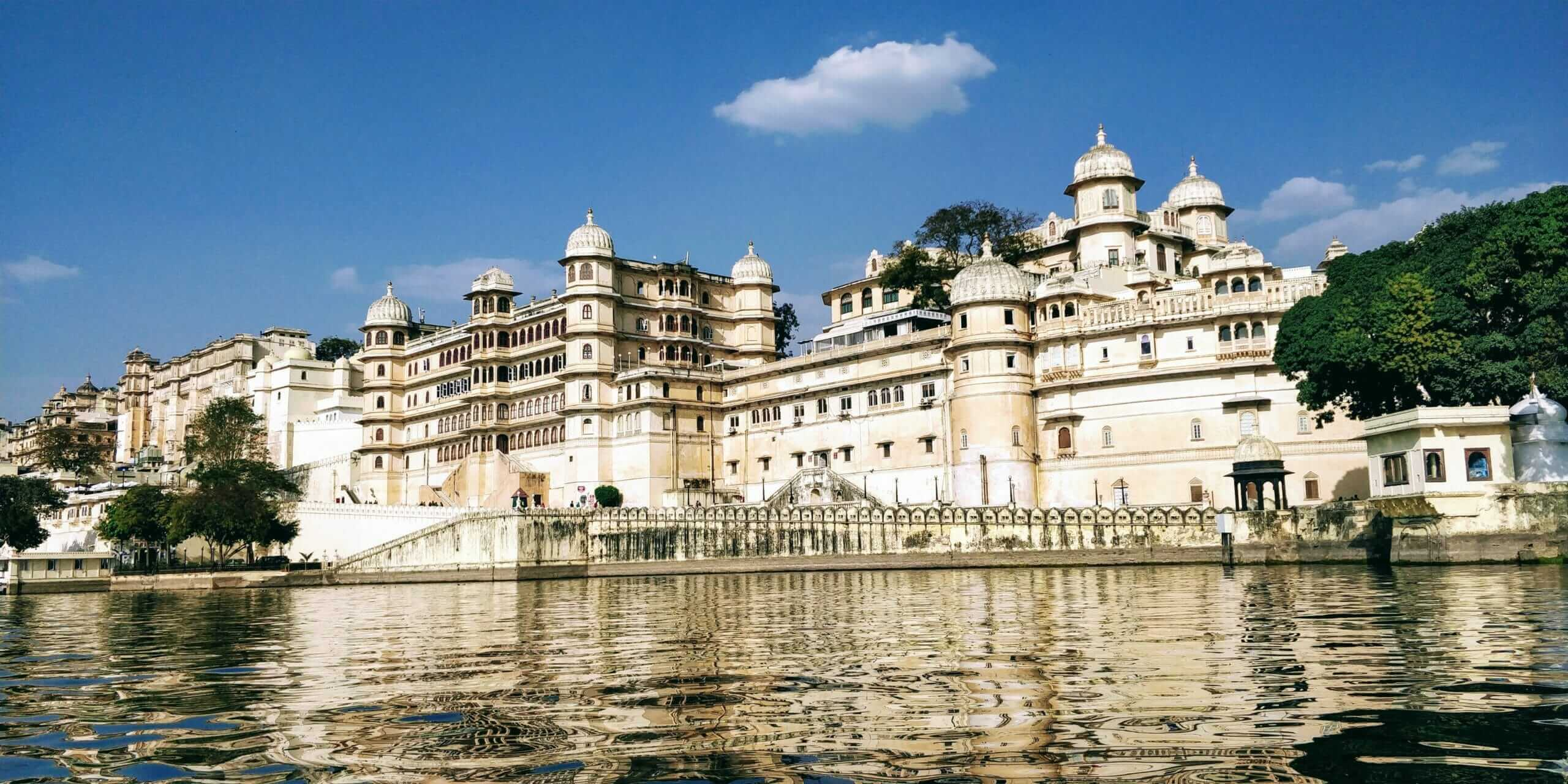 While backpacking Udaipur, be sure to visit the City Palace and take a boat out on Lake Pichola for a great view