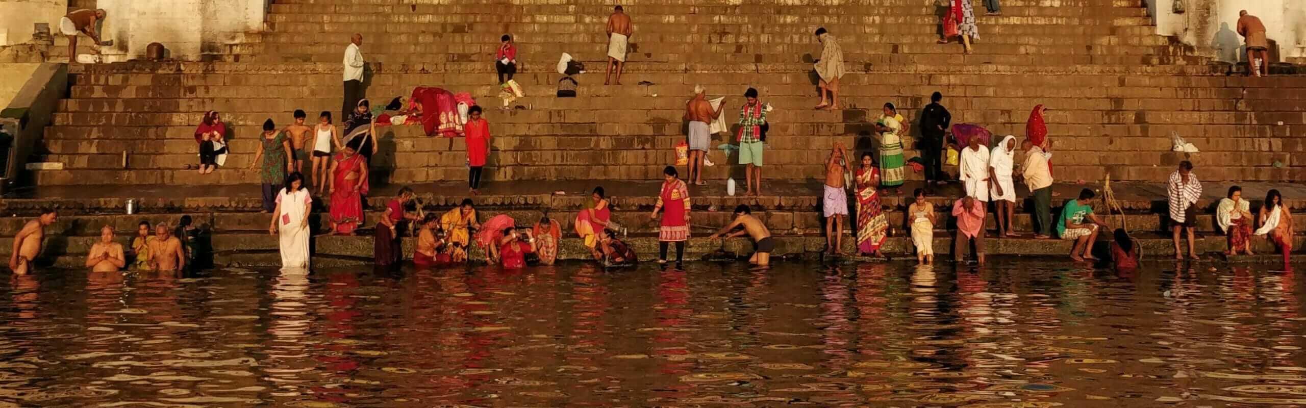 Hindus bathing in the polluted Ganges River in Varanasi at the Vijaya Nagaram Ghat