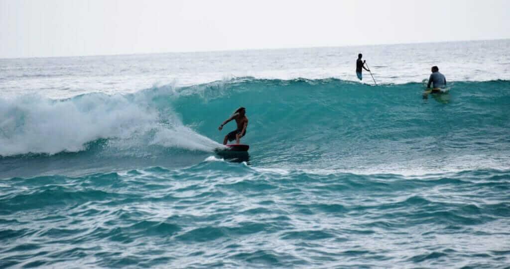 Hawaiian surfers shredding gnarly waves on the Big Island