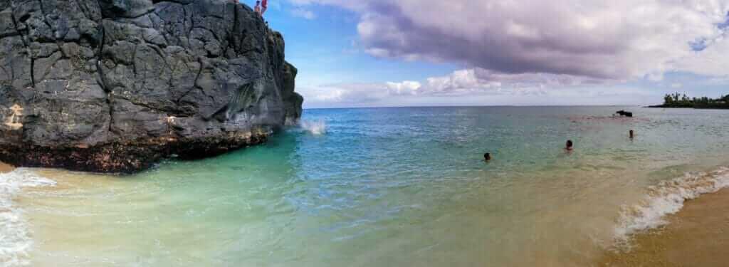Cliff jumping in Waimea Bay