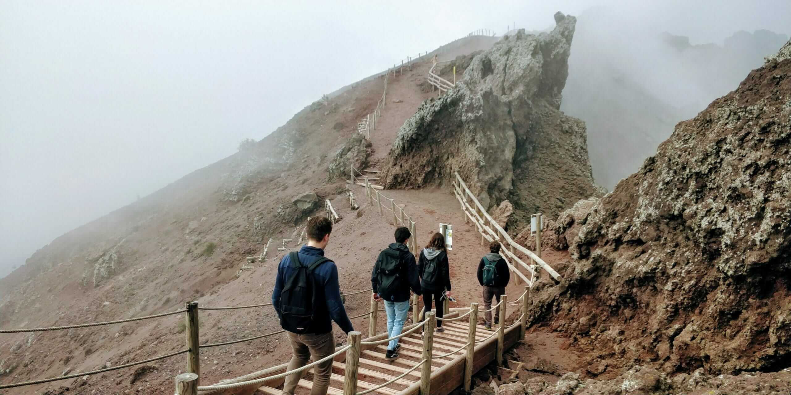 Hiking around Mount Vesuvius volcano crater ridge