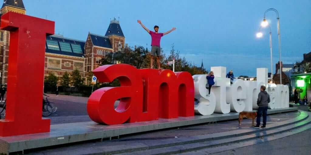 Standing on the I Amsterdam sign