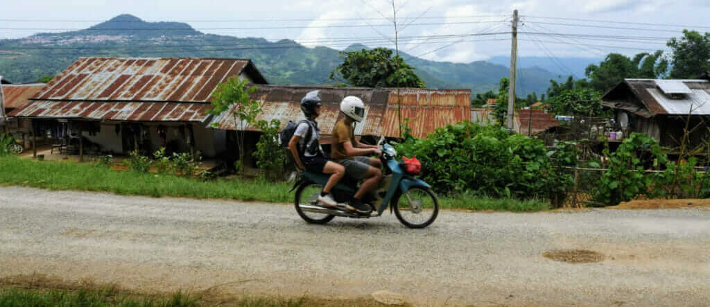 Male and female on a motorbike rental in Phongsaly Laos